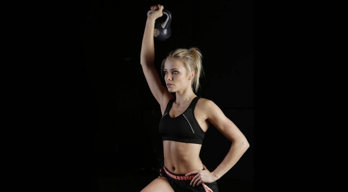 Girl working out with a kettlebell