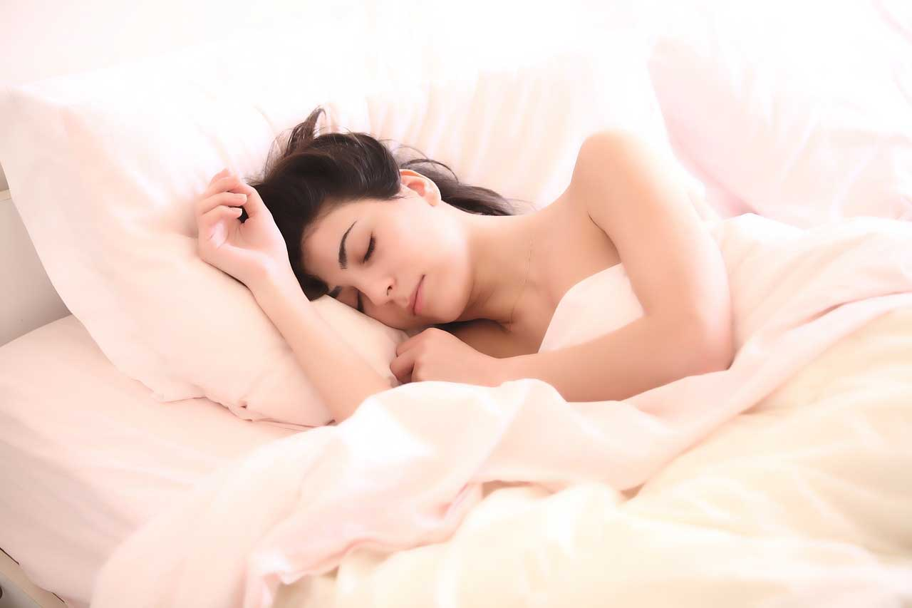 sleeping girl on bed