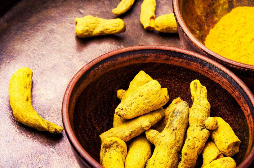 Roots and turmeric powder